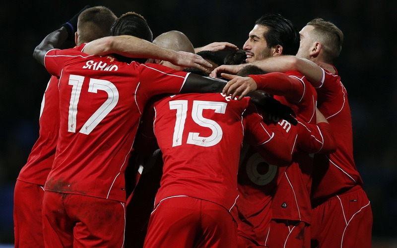 Liverpool's Philippe Coutinho (unseen) celebrates after scoring during their FA Cup fourth round replay soccer match against Bolton Wanderers at the Macron Stadium in Bolton, northern England February 4, 2015. REUTERS/Andrew Yates (BRITAIN - Tags: SPORT SOCCER)